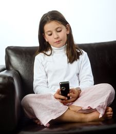 Young Girl And Cell Phone Royalty Free Stock Image
