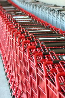 Row Of Red Metal Shopping Carts Stock Photography