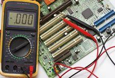 Memory Circuit Board And Multimeter Royalty Free Stock Image