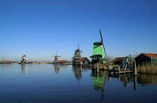 Four Wind Mills On A Row Stock Photos