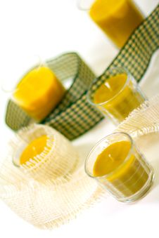 Five Yellow Candles And Ribbon Stock Image