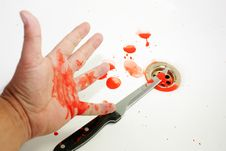 Bloodied Knife And Hand Stock Images