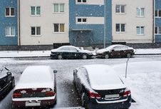 Four Cars Near The House In The Snow Royalty Free Stock Image
