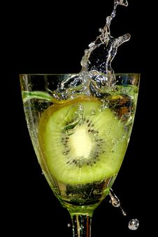 Free Kiwi In Sparks Of Water Stock Photo - 6863460