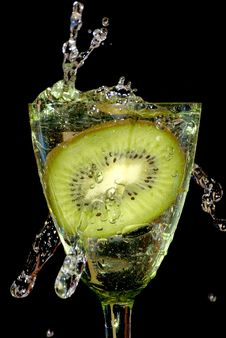 Free Kiwi In Sparks Of Water Stock Images - 6863474