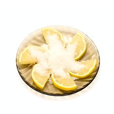 Lemon Slices And Sugar On Plate Stock Images