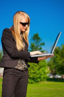 Businesswoman Working On Laptop Royalty Free Stock Photography