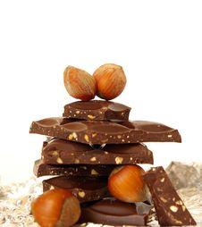 Chocolate Blocks And Nuts Royalty Free Stock Photos