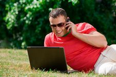 Free Young Man Working Over A Laptop Stock Image - 6868561