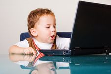 Free Small Boy With A Laptop Royalty Free Stock Photography - 6868817
