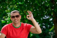 Young Man Giving OK Gesture Royalty Free Stock Photo