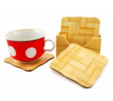 Colored Cup And Set Of Wooden Trivets Stock Photo