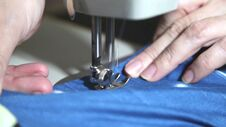 Free Woman S Hands Sewing On The Sewing Machine Stock Image - 68613571
