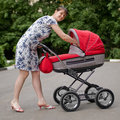Free Woman With Baby Carriage Stock Photo - 6870380