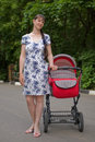 Free Woman With Baby Carriage Stock Photos - 6870413