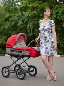 Free Woman With Baby Carriage Royalty Free Stock Image - 6870406