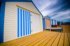 Colourful Beach Huts With Dramatic Sky Royalty Free Stock Photography