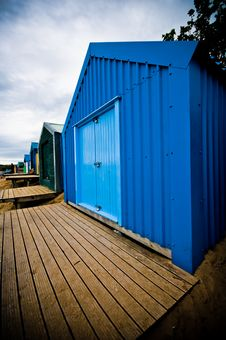 Colourful Beach Huts With Dramatic Sky Royalty Free Stock Photos