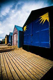 Colourful Beach Huts With Dramatic Sky Stock Images