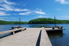 Free Concrete Dock In Calm Blue Lake Royalty Free Stock Image - 6871406