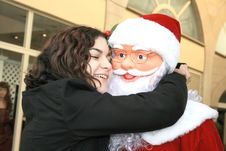 Free The Girl Hugging Santa Clause Royalty Free Stock Photography - 6873887