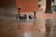 Free Brass Chess Figures On Reflective Surface Royalty Free Stock Photography - 6873987