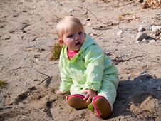 Free Baby Sits On Sand Stock Photo - 6878080
