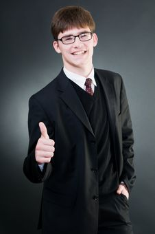 Free Young Handsome Businessman Showing Thumbs Up Royalty Free Stock Photo - 6879775