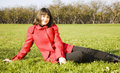 Free Young Woman Sitting On The Grass Royalty Free Stock Photography - 6880487