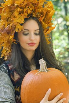 Free Girl With A Pumpkin Stock Image - 6880541