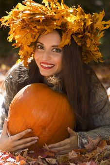 Free Girl With A Pumpkin Royalty Free Stock Photography - 6880557