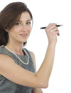 Businesswoman With A Pen In Hand Royalty Free Stock Photo
