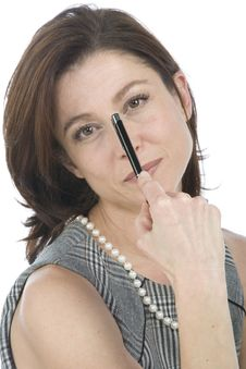 Businesswoman With A Pen In Hand Royalty Free Stock Photography