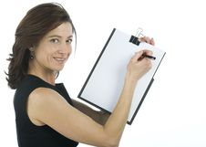 Adult Secretary Shows A Blank Paper Royalty Free Stock Image
