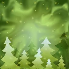 The Background Showing Fur-trees Under A Snowfall. Stock Image