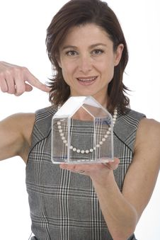 Portrait Of 40s Woman With A Transparent House Royalty Free Stock Image