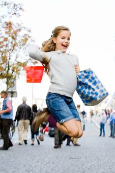 Young Girl Is Jumping On The Streets Stock Image