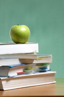 Free Apple On Stack Of Books In Classroom Stock Photos - 6885403