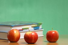 Free Apple On Stack Of Books In Classroom Royalty Free Stock Photography - 6885647