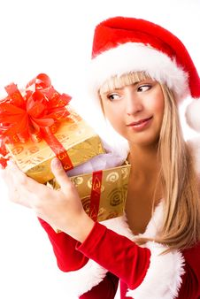 Free Beautiful Girl Looks Into The Christmas Present Stock Photos - 6887403