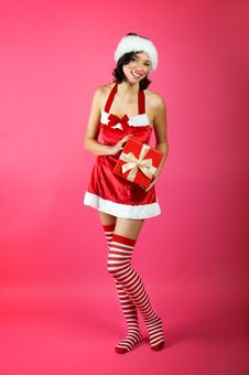 Free Christmas Woman With A Gift Royalty Free Stock Images - 6888379