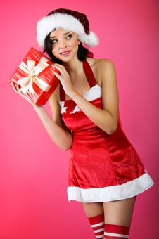 Free Christmas Woman With A Gift Stock Photo - 6888500