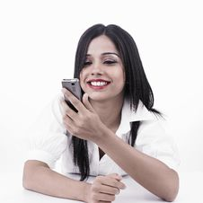 Free Girl Looking At Her Cell Phone Royalty Free Stock Photo - 6888945