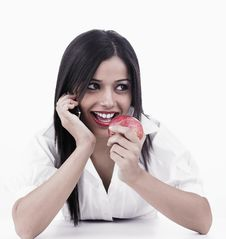 Asian Girl Eating A Apple Royalty Free Stock Photography