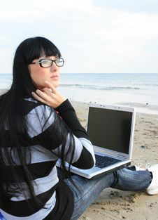 Free Woman On Beach With Laptop Stock Image - 6888991