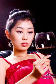 Girl And Red Wine Royalty Free Stock Image