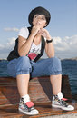 Free Rebel Young Woman Sitting Near The Sea Royalty Free Stock Photography - 6898157