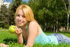 Free Pretty Woman Eating Green Apple Stock Photos - 6893753