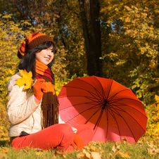Young Woman On The Autumn Leaf Royalty Free Stock Photos