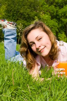 Free Woman Drinking Juice On The Summer Glade Stock Images - 6895254